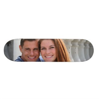Young Couple Bridge Skate Boards