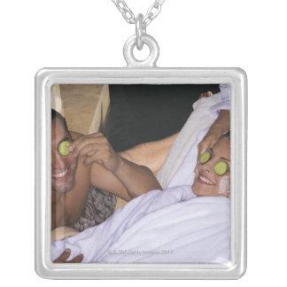 Young couple enjoying a spa treatment. pendants