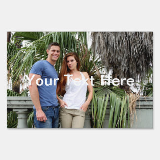 Young Couple Palm Tree Lawn Sign