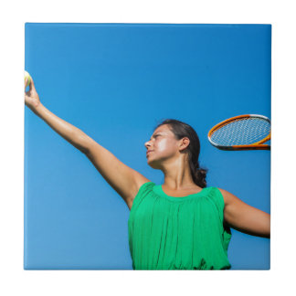 Young dutch woman with tennis racket and ball ceramic tile