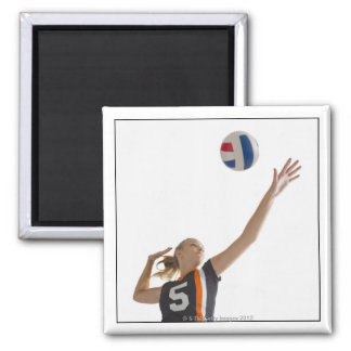 Young girl (16-17) playing volleyball 2 inch square magnet