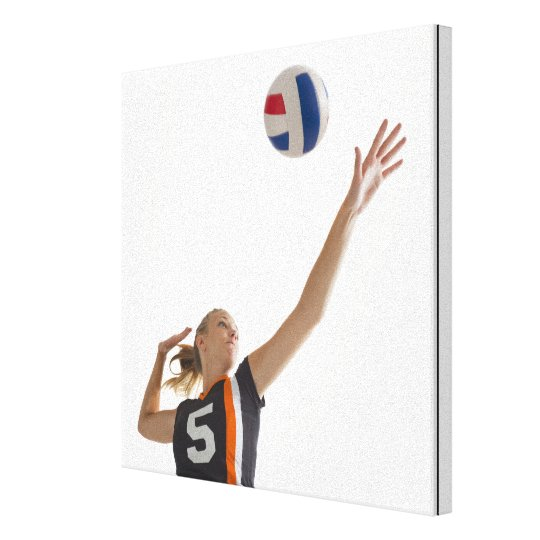 Young girl (16-17) playing volleyball canvas print