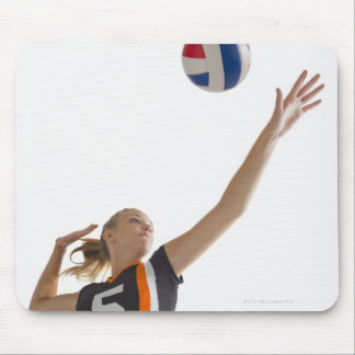 Young girl (16-17) playing volleyball mouse pad