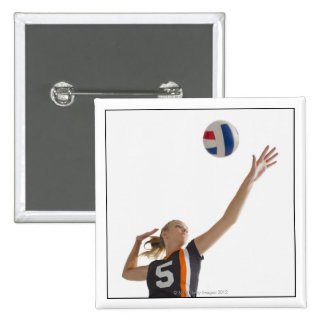 Young girl (16-17) playing volleyball pinback button