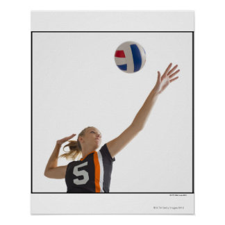 Young girl (16-17) playing volleyball poster