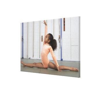 Young girl gymnast practicing her floor canvas print