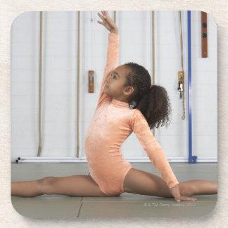 Young girl gymnast practicing her floor coaster