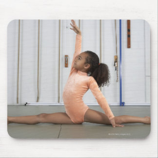 Young girl gymnast practicing her floor mouse pad