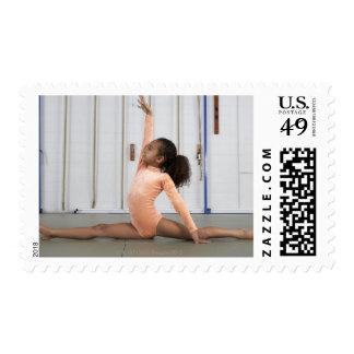 Young girl gymnast practicing her floor postage
