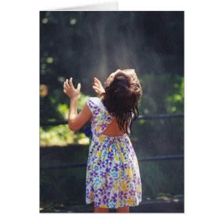 Young girl on a hot summer day. greeting card