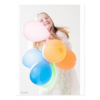 young girl with balloons postcard