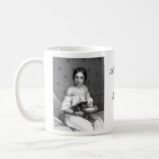 Young girl with kitten and bowl of milk coffee mug