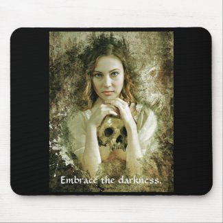 Young girl with skull mouse pad