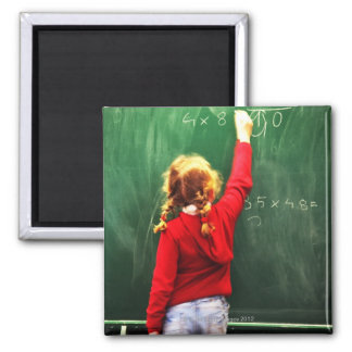 young girl writing on a blackboard 2 inch square magnet
