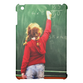 young girl writing on a blackboard cover for the iPad mini
