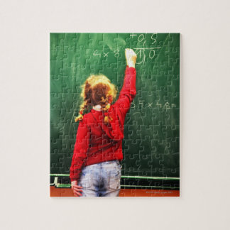 young girl writing on a blackboard puzzles