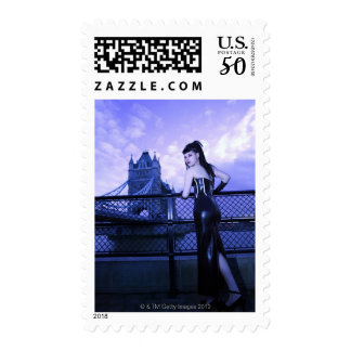 Young Goth woman at Tower Bridge, London Postage