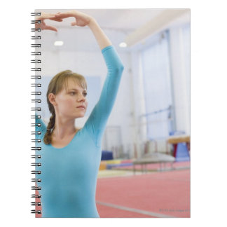 Young gymnast posing notebook