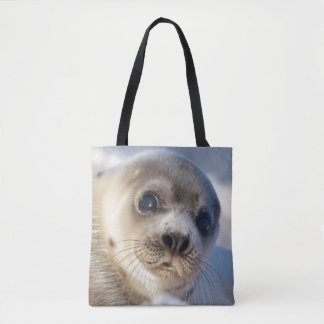 Young harp seal starting to shed its coat tote bag