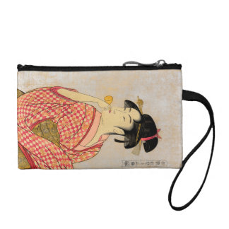 Young Lady Blowing on a Poppin. Coin Wallet