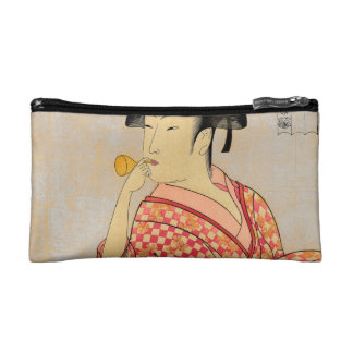 Young Lady Blowing on a Poppin. Cosmetic Bag