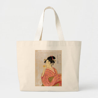 Young Lady Blowing on a Poppin. Large Tote Bag