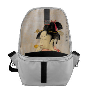 Young Lady Blowing on a Poppin. Messenger Bag