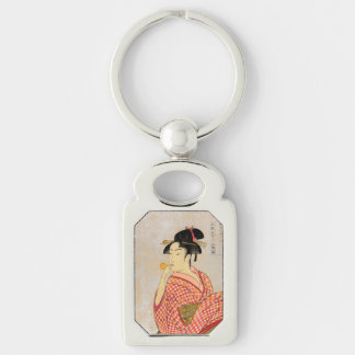 Young Lady Blowing on a Poppin. Silver-Colored Rectangular Metal Keychain