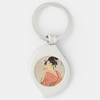 Young Lady Blowing on a Poppin. Silver-Colored Swirl Metal Keychain