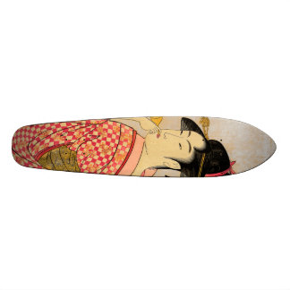 Young Lady Blowing on a Poppin. Skateboard