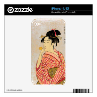 Young Lady Blowing on a Poppin. Skin For The iPhone 4