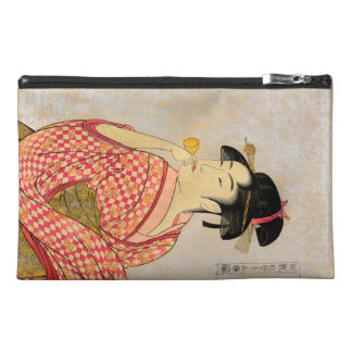 Young Lady Blowing on a Poppin. Travel Accessory Bags
