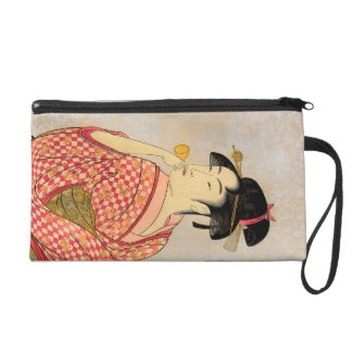 Young Lady Blowing on a Poppin. Wristlet Purse