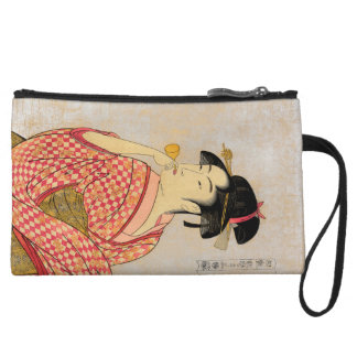 Young Lady Blowing on a Poppin. Wristlet Wallet
