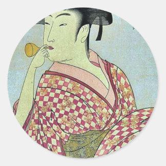 Young lady blowing on poppin by Kitagawa,Utamaro Classic Round Sticker