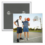 Young man and senior man on outdoor basketball button