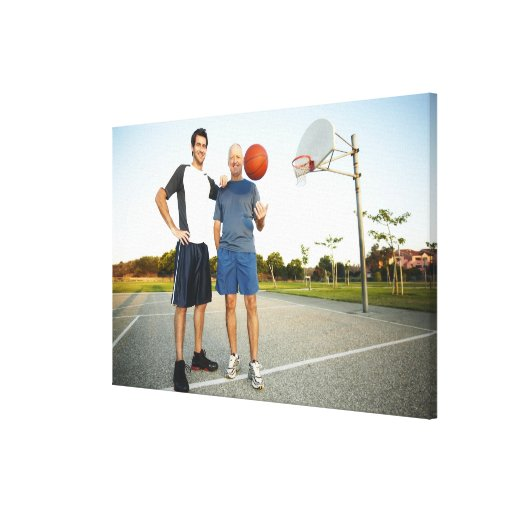Young man and senior man on outdoor basketball canvas print