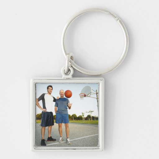 Young man and senior man on outdoor basketball Silver-Colored square keychain