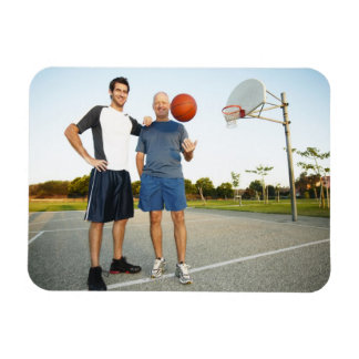 Young man and senior man on outdoor basketball magnet