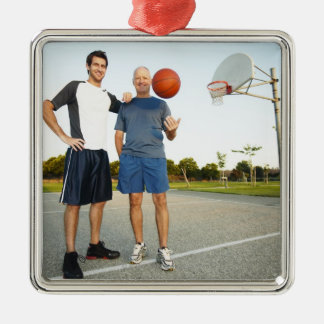Young man and senior man on outdoor basketball metal ornament