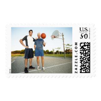 Young man and senior man on outdoor basketball postage