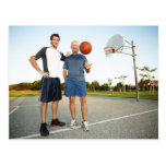 Young man and senior man on outdoor basketball postcard
