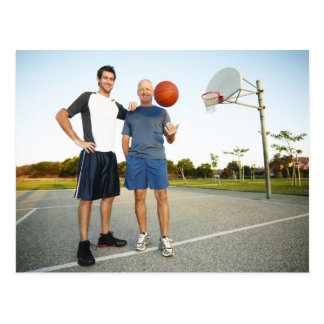 Young man and senior man on outdoor basketball postcard