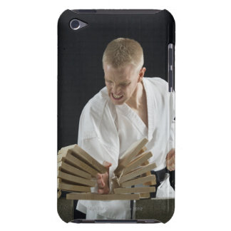Young man breaking boards with karate chop on iPod Case-Mate case