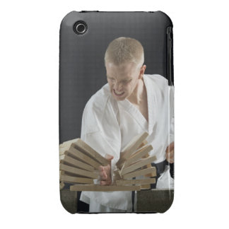 Young man breaking boards with karate chop on Case-Mate iPhone 3 cases