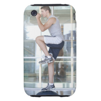 young man doing step-up exercises on a balance tough iPhone 3 cases