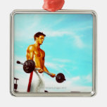 Young man exercising with barbells christmas tree ornaments