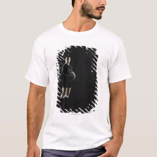 Young man holding rugby ball, portrait T-Shirt