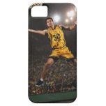 Young man jumping and holding basketball iPhone 5 case