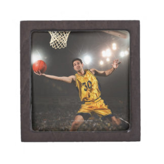 Young man jumping and holding basketball gift box